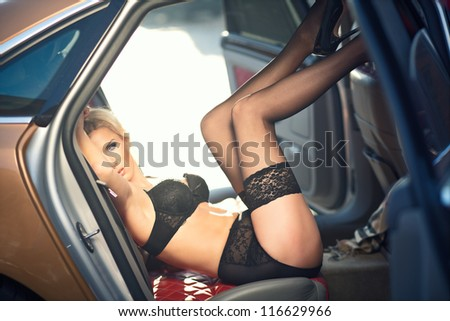 Sexy lady in a sport car - stock photo
