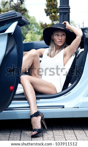 Sexy lady in the sport car - stock photo