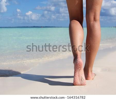 Sexy Legs on Tropical Sand Beach. Walking Female Feet. Closeup - stock photo