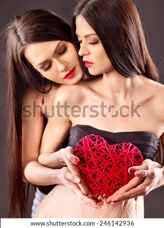 Sexy lesbian women taking heart in erotic foreplay game. Valentin day. - stock photo