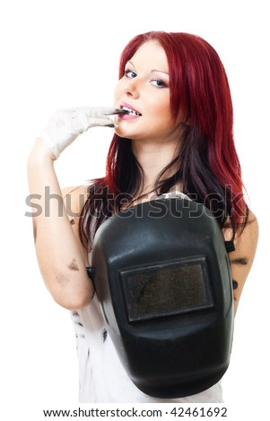 Sexy looking attractive woman welder standing with mask - stock photo