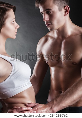 Sexy love couple on a dark background - stock photo
