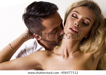 Sexy lovers foreplay, sensual men foreplay with young woman - stock photo