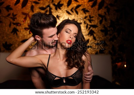 Sexy lovers in bed at night close together, foreplay - stock photo