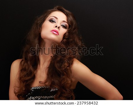 Sexy makeup female model with curly long brown hair posing - stock photo