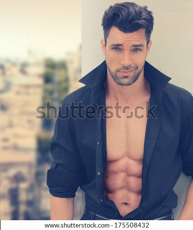 Sexy male fashion model with open shirt and nice abs - stock photo