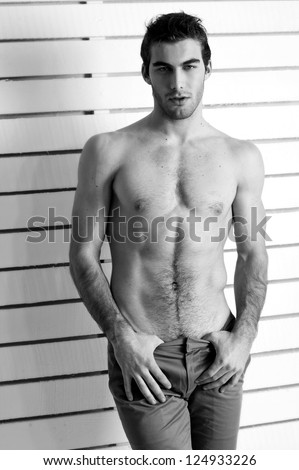 Sexy male model. Black-and-white photo.