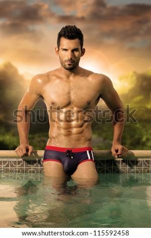 Sexy naked men swimming