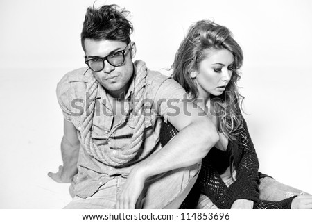 http://thumb9.shutterstock.com/display_pic_with_logo/173680/114853696/stock-photo-sexy-man-and-woman-doing-a-fashion-photo-shoot-in-a-professional-studio-bw-retro-mood-114853696.jpg