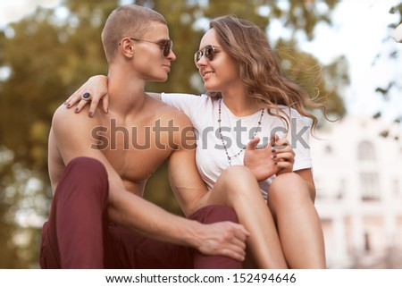 Sexy man and woman doing a fashion photo shoot in  sunset