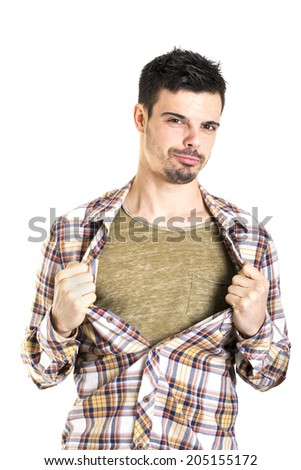 Sexy man is tearing his t-shirt on a white background - stock photo