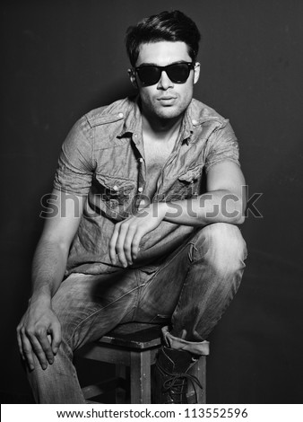 Sexy man looking cool - vintage stylized black and white photo (Photo has an intentional film grain) - stock photo