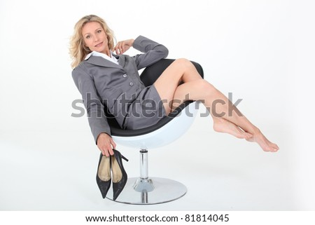 Sexy mature woman relaxing - stock photo