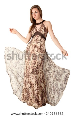 Sexy model in animal print long dress. - stock photo