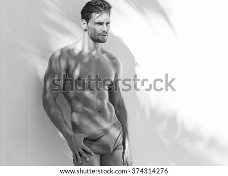 Sexy model in beach shorts - stock photo
