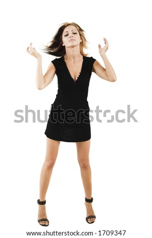 Sexy model isolated on white with hair blown by the wind posing in a cute black dress - very high resolution - stock photo