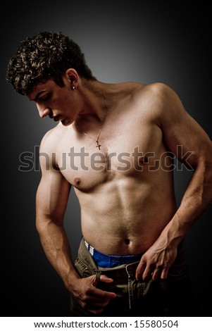 Sexy muscular guy posing on grey background - stock photo