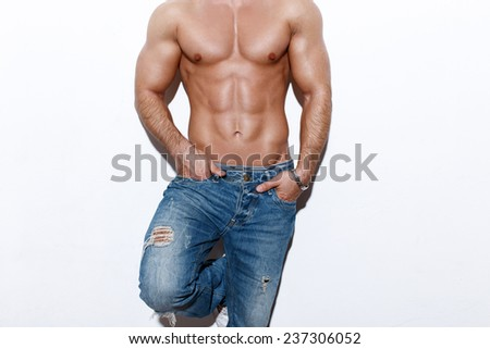 Sexy muscular man body, posing at white wall - stock photo