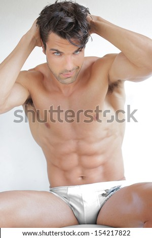 Sexy muscular man in white underwear - stock photo