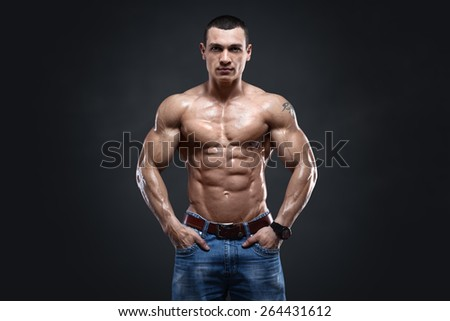 Sexy muscular man isolated with clipping path on dark background - stock photo