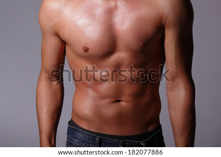 Sexy muscular young man. Isolated on gray background. asian and european mixed blood