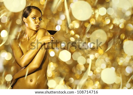 sexy naked golden woman with the  glass of wine - stock photo