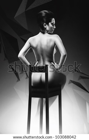 sexy naked woman on black chair - stock photo