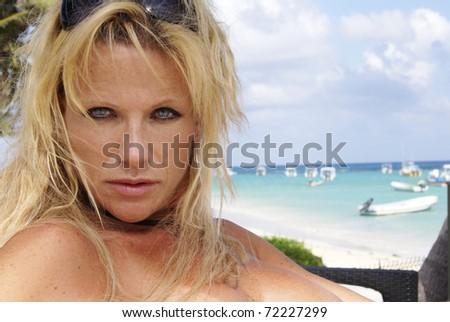 Sexy nude blond headshot at the beach - stock photo