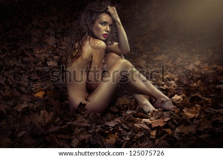 Sexy nude woman in nature scenery - stock photo
