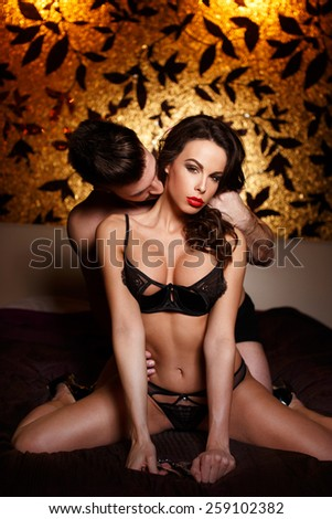 Sexy passionate couple foreplay on bed, bdsm - stock photo