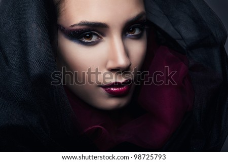 sexy passionate woman in black hood - stock photo