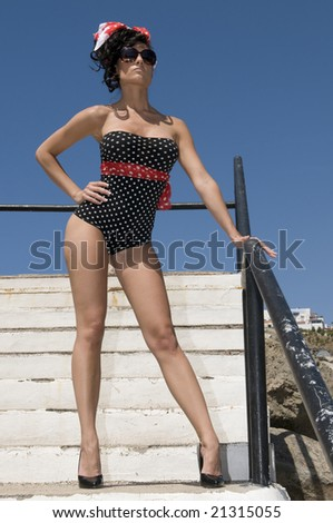 sexy pin up woman near the sea - stock photo