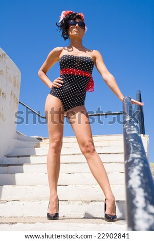 sexy pin up woman near the sea on blue day - stock photo