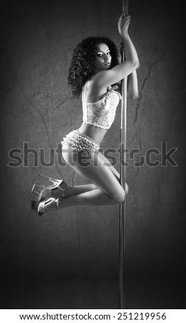 Sexy pole dancer - stock photo