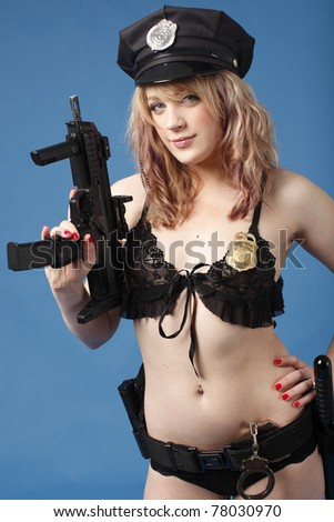 Sexy police officer with gun and baton.
