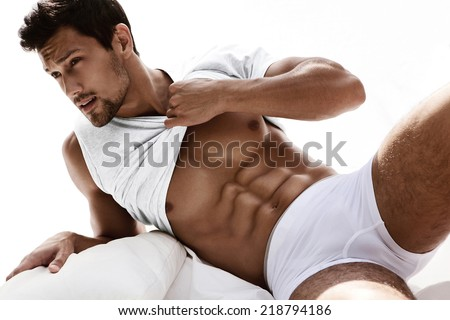Sexy portrait of a very muscular male model in underwear - stock photo