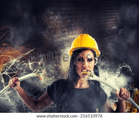 Sexy rebel girl breaks big electrical cables - stock photo
