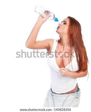 Sexy red hair woman in wet white t shirt drinking water
