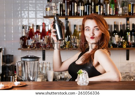 Sexy redhead bartender - stock photo
