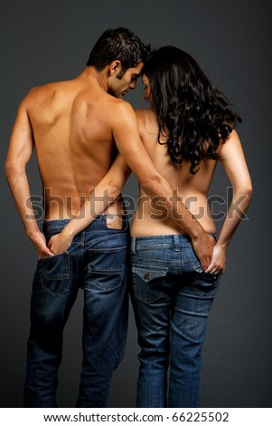 Sexy romantic young couple in jeans - stock photo