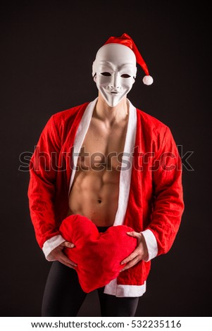 sexy santa claus wearing mask on black background