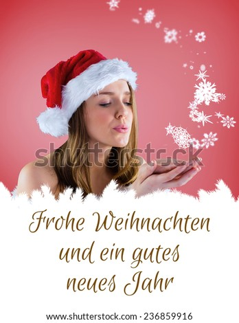 sexy santa girl blowing over hands against christmas greeting in german - stock photo
