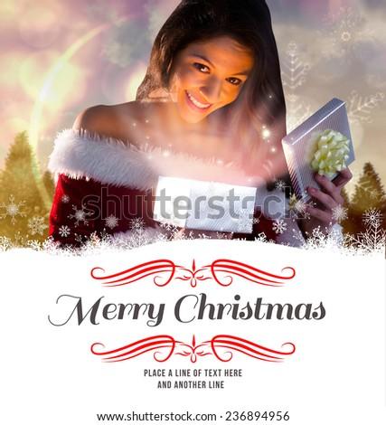 sexy santa girl opening gift against border - stock photo