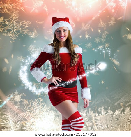 Sexy santa girl smiling at camera against cream snow flake pattern design
