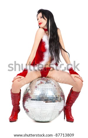 Sexy santa helper with big disco ball isolated on white background