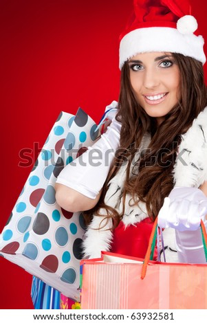 sexy santa woman holding colorful shopping bags