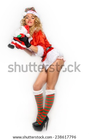 Sexy Santas Helper girl great image for creating Holiday Greeting postcards or computer wallpapers - stock photo