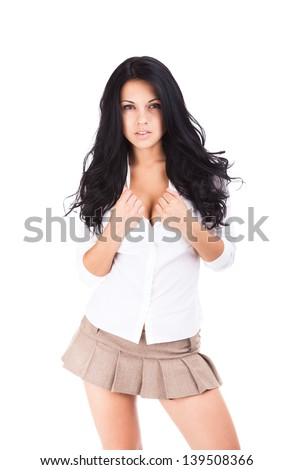 sexy school student girl in short skirt isolated over white background - stock photo