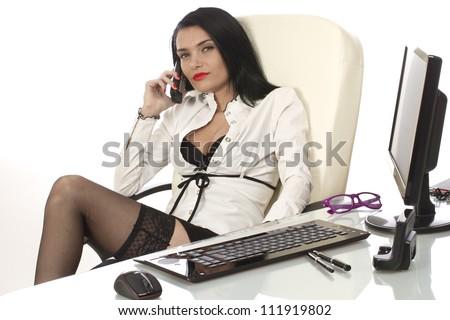 Sexy secretary at her office desk - stock photo