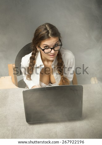 sexy secretary sitting with bra out - stock photo